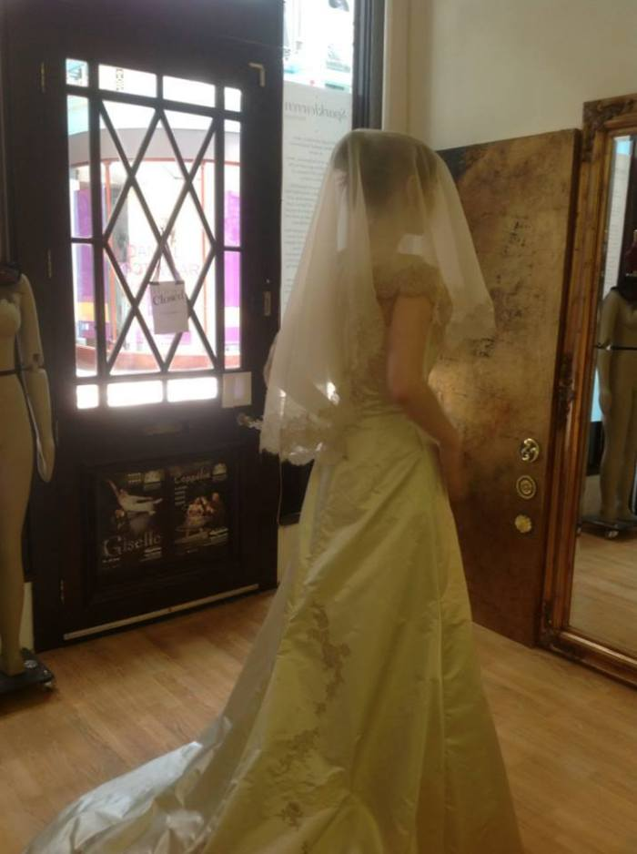 One of our fittings. We ended up arranging the veil differently, but I love this shot just because of how elegant Lou looks. That veil's lace edging was all hand cut and sewn, muted pink or champagne organza. An absolute dream, like a faded vintage gown. This is what we strive to create, future heirlooms.
