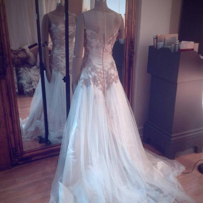 Oh, I still love the way the tulle drops from the lace at the back here... We've referenced this idea since (for example in the Cloud gown), but I'd love to visit it once again. I think it's so timeless and elegant.