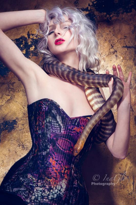 Cassie Rae by InaGlo Photography.  The Python corset ended up having spikes and crystals added. But beneath all that it was really about patterning. An already intricate snake-print silk was broken up further by multiple seams in a Birds Wing corset design.