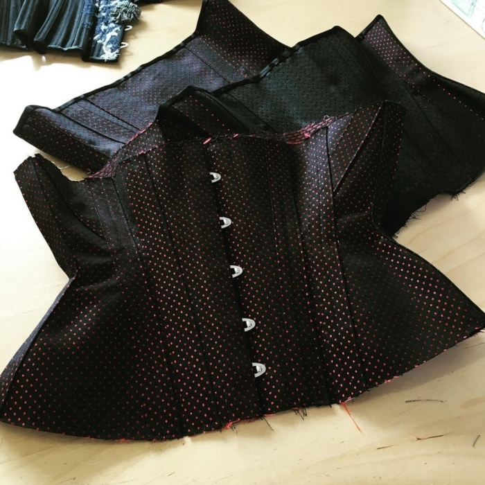 Three of our corsets, almost ready for sale. We're working through and using up all our bits of broche, etc. Which is nice, since people often ask us to do classics but I don't often do them, preferring shiny silk pieces.