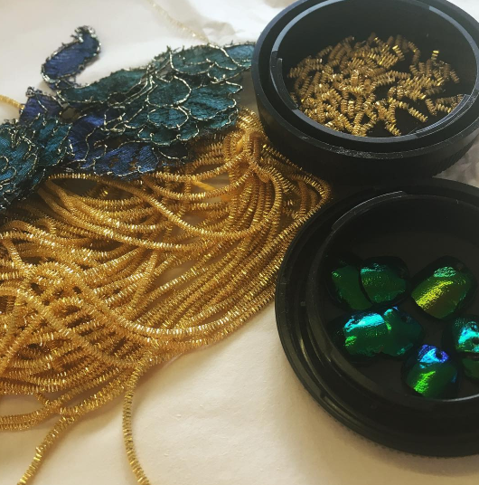 And we've begun scattering a few beads cut from goldwork. The Scarab is going to be a beautiful and strong piece of couture corsetry.
